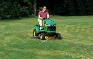 Spiral pattern mowing with riding lawn mower